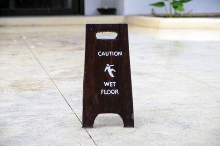 wet floor: Sign warning of caution wet floor on floor Stock Photo