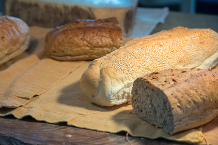 dekorated: Homemade fresh bread on wooden table, selective focus Stock Photo