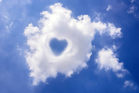 Heart in cloud on the blue sky photo