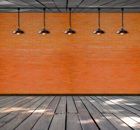 Lamp at brick wall background with ground wood photo