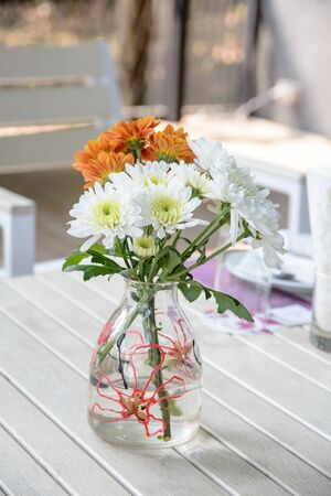 home accent: Flowers in glass vase on wood table