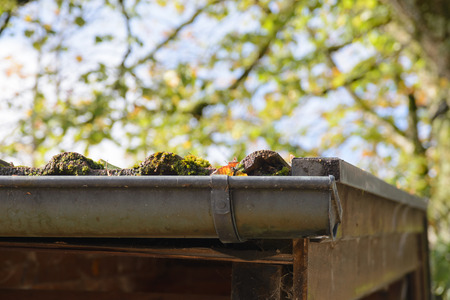 housetop: Close-up of a gutter at a roof. Stock Photo