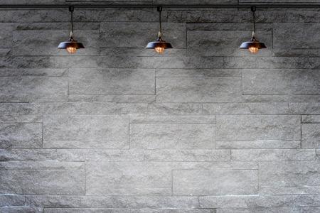 Granieten stenen decoratieve bakstenen muur met lamp Stockfoto