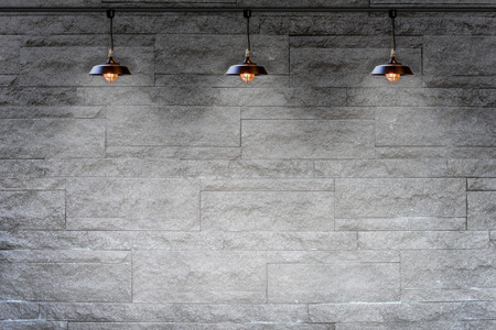 stone wall: Granite stone decorative brick wall with lamp Stock Photo