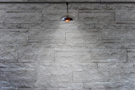 backdrop design: Granite stone decorative brick wall with lamp Stock Photo