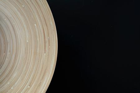 curvature: Wooden plate curvature on black background