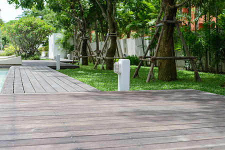 walkway: Wooden Walkway with street lamp in the garden
