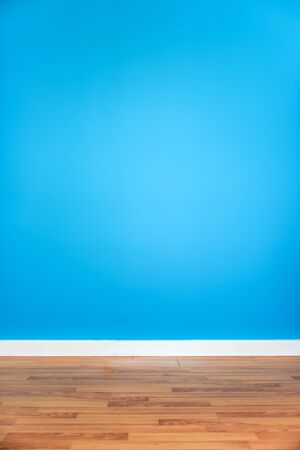 blank space: Blue wall with wooden floor, empty room Stock Photo