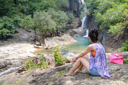 chang: Women tourist watching the waterfall on Koh Chang or Chang island, Thailand Stock Photo