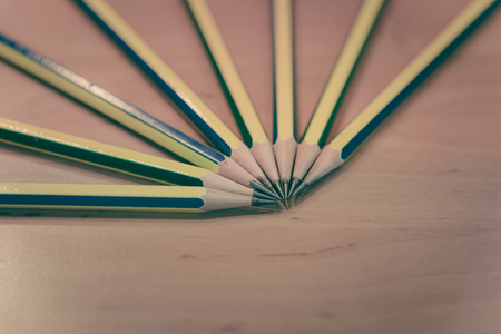 educational tools: closeup of wooden pencils on the wooden table and selective focus with copy space - back to school concept, old retro vintage style Stock Photo