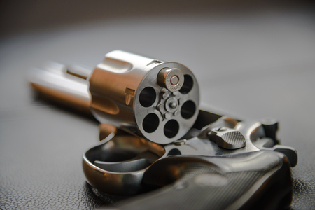 leather furniture: .357 Caliber Revolver Pistol, Revolver open ready to put bullets on leather furniture