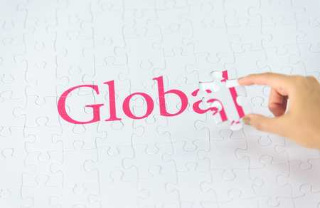 embed: Hand embed missing a piece of Global word Stock Photo