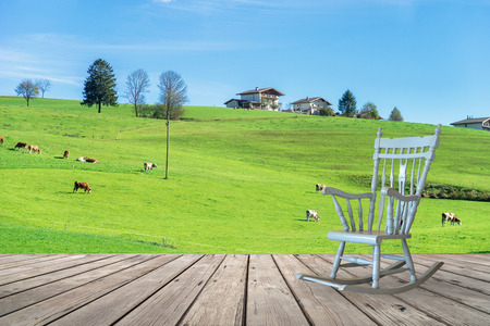 rocking chair: Rocking chair on wooden terrace with countryside view