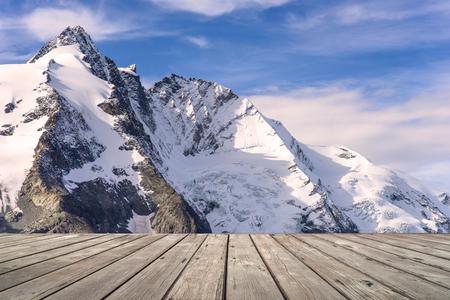 franz: Empty wooden terrace with Mountain view of Franz Josefs Hohe Glacier, Austria on background.