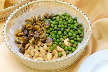 broad bean: Broad bean or fava bean, Peas and Cashews roasted with salty in basket