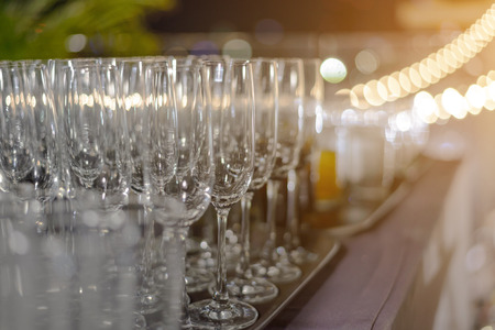 identical: Empty champagne glasses ready for party - drink, vacation and celebration concept Stock Photo