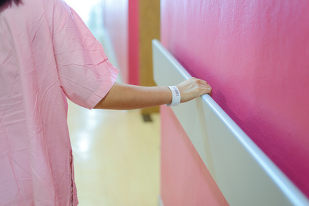 women patient hand holding to handrail in hospital, support, help concept