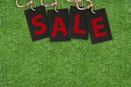 Sale Tags on Green Grass with copy space