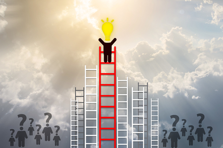 Idea concept. man have idea standing on top of ladder with Cloud background. Stock Photo