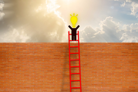 Success concept. man have idea standing on top of ladder over brick wall with Cloud background.
