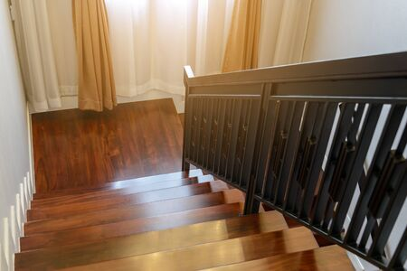 wooden stairway with wooden railing in model home Stock Photo