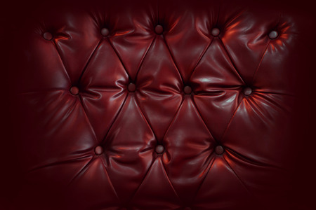 button tufted: Close up retro chesterfield style, capitone textile background