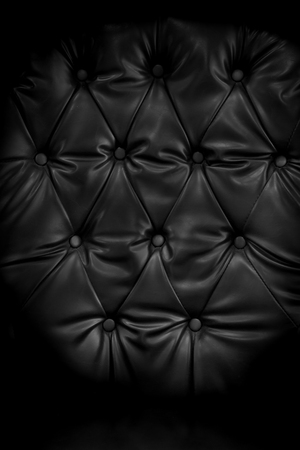 Close up retro chesterfield style, capitone textile background