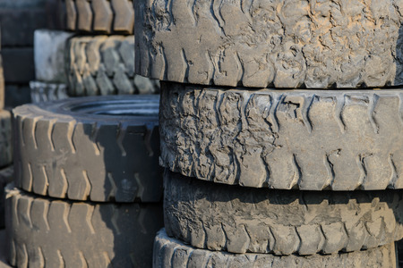dirty car: Column stack of old forklift tire