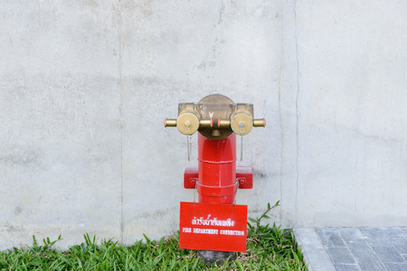 Fire hydrant manifold two outlet water valve. Fire department connection Stock Photo