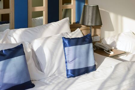 hotel bedroom: Pillows on bed decoration in modern bedroom interior