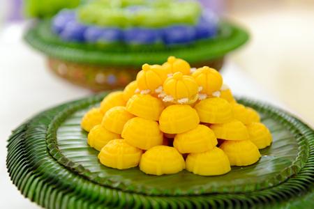 jah: Thai traditional dessert Jah Mong Kut - Egg Yolks Dumpling in Wheat Flour Crown Stock Photo