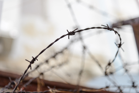 barbed wire fence lack - symbol of danger