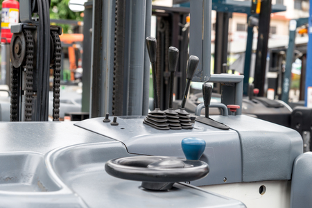 construction project: Focus to levers wheel control in cabin forklift truck