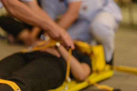 Abstract blurred of first aid training about moving patient by stretcher