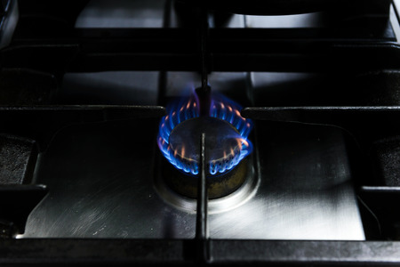 flames burning from gas stove