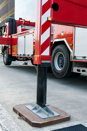 ladder fire truck Hydraulic outrigger stabilizing legs extended. Stock Photo