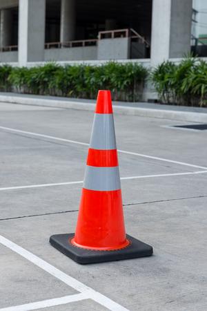 Orange traffic cone on concrete floor. road sign