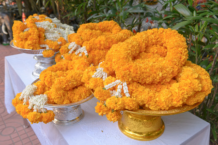 Marigold and Jasmine garland on tray prepared for paying respect in the Buddhist temple