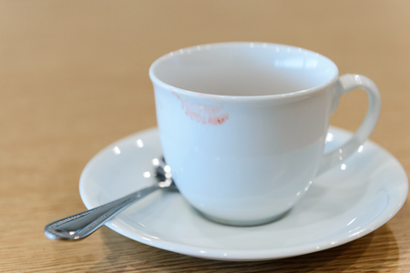 lipstick stain from a woman on ceramic coffee cup - coffee break