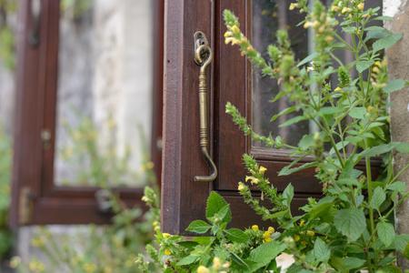 close up of vintage brass window hook for lock window when it open Stock fotó