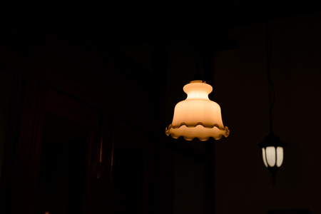 antique lamp hanging from the ceiling with copy space. Dark Tone