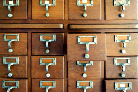 Old wooden vintage Medicine drawer cabinet. Catalog file cabinet. Data storage