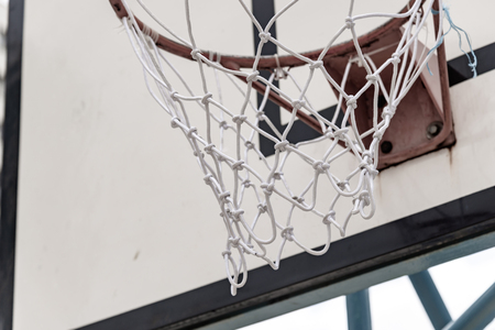 Basketball hoop outdoors at cloudy day. Sport concept