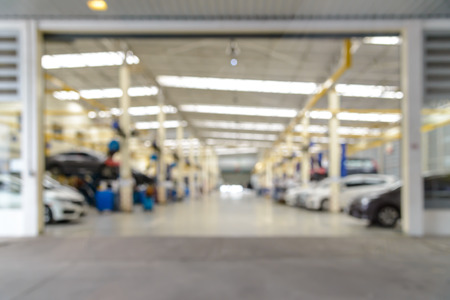 Abstract blur of auto repair service at garage. use for background