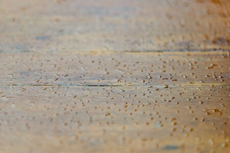 water drops on wooden surface. droplets of raindrop. background