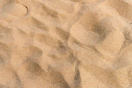 Yellow sand texture on the beach. natural background for summer concept