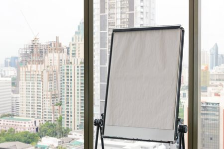Blank flip chart with city view on background, Business brainstorm concept