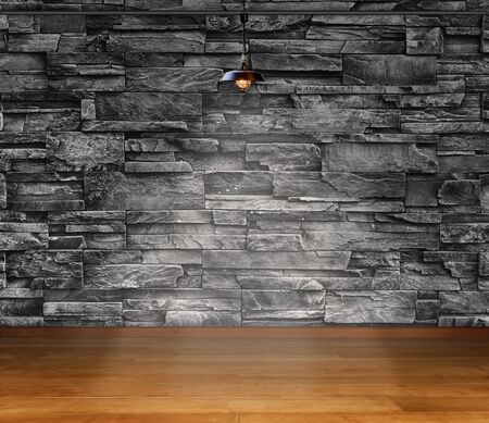 Empty room - granite stone decorative brick wall with lamp and laminate flooring interior background, interior template for product display