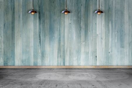 Empty room - wooden wall with lamp and laminate flooring. User for background Foto de archivo - 129254330