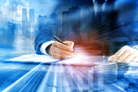 Double exposure of business person signing contract document or concluding agreement with coins money and immovable property - financial and investment concept Imagens